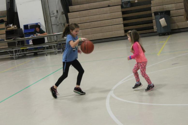 Vice Principal Vincent Shivas' daughters play basketball