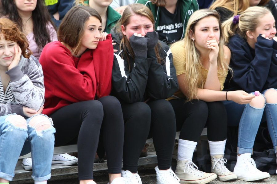 [From left to right] Senior Christina Franco, Junior Marisa Lametto, Junior Sam Zacarias, and Junior Isla Hamilton react to the mock crash scene.
