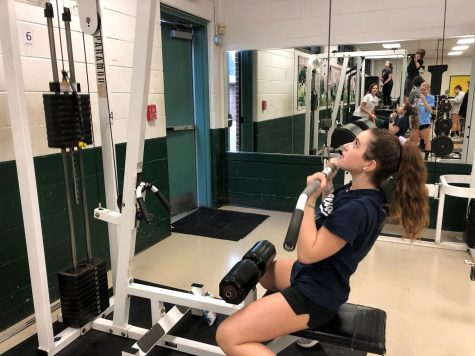 Emily Stitzel doing pull downs in the fitness center.