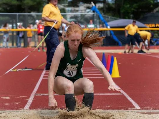 Senior Kathryn Brown competing in triple jump.