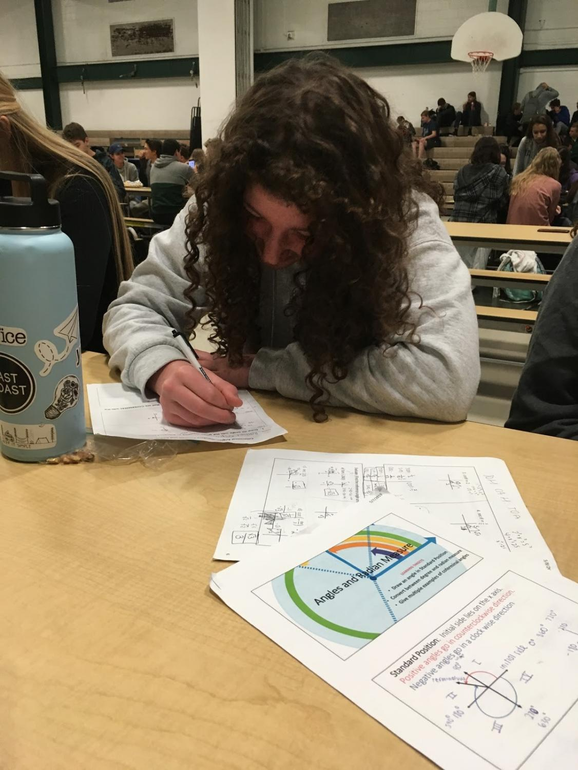 Sarah Armstrong staying hydrated while taking notes on what she did in math class so she does not forget.