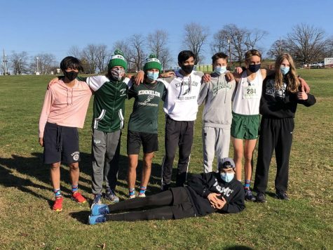 Cross Country Boys team posing after Sectionals win.