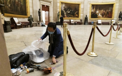 Image from NBC News. One of the most powerful pictures in American history: New Jersey Congressman Andy Kim on his hands and knees cleaning up the mess in the aftermath of the attempted siege.