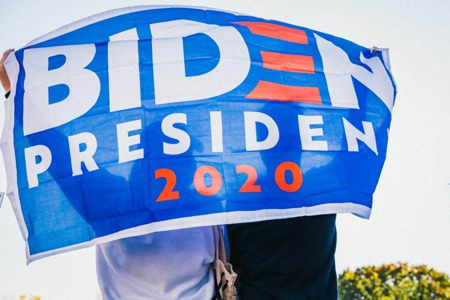 A Biden campaign flag held by supporters.