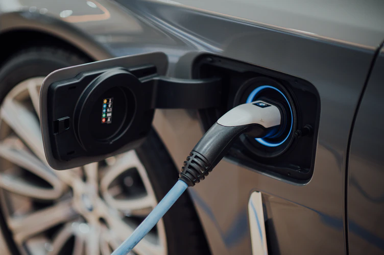 As humanity continues into the future, electric cars are replacing gas cars, which is taking the markets by storm.  Photo from Chuttersnap, from UnSplash.com