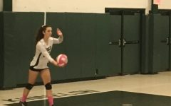 Beth Malone gets ready to serve the ball to at a volleyball game last season.
