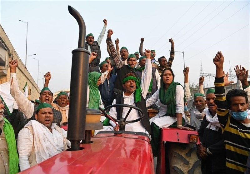 Photo courtesy of tasnimnews.com. Indian Farmers and their families come together to protest against Indian Primeminister Modi's latest agriculture law's adding restrictions on farmers.