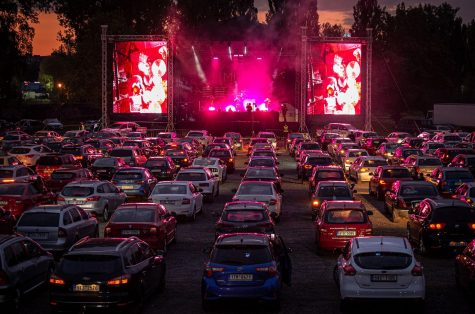 A drive-in concert being performed with a sold out crowd in Los Angeles
